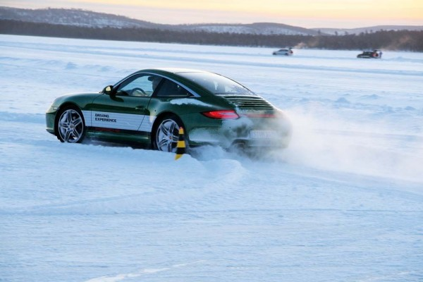 porsche 911 sliding in snow at the winter driving camp