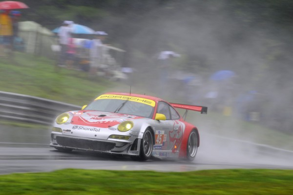 Flying Lizard Porsche 911 GT3 RSR racing in the rain at Lime Rock