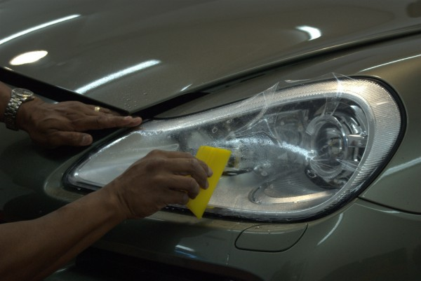 invisible bra material being installed on Porsche Cayenne headlight