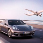 Porsche panamera Turbo S with jet flying next to it