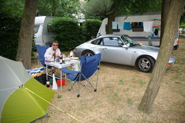 Chris Bayliss and his Porsche 993 at a campsite