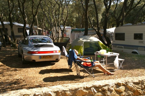 sarah bayliss getting sun next to her Porsche campsite
