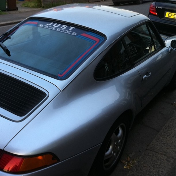 porsche 993 with a just married decal in rear window