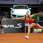Maria Sharapova reaching for a shot at 2012 Porsche Tennis Grand Prix