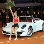 Maria Sharapova sitting on the hood of a 2012 Porsche 911 Cabriolet