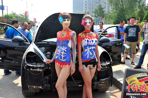 half naked chinese girls posing with Porsche Cayenne