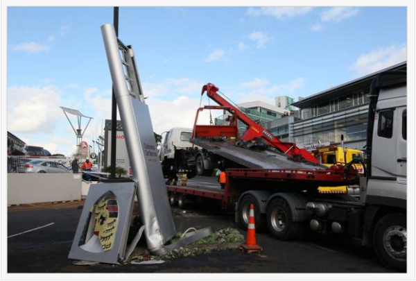 truck crash auckland Porsche dealership