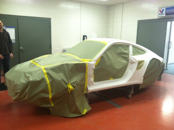falken porsche taped and waiting for paint in the booth