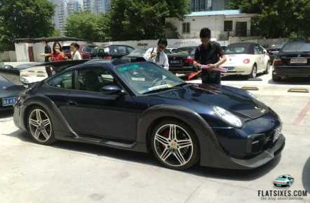 a really ugly aftermarket bodykit on a Porsche in China