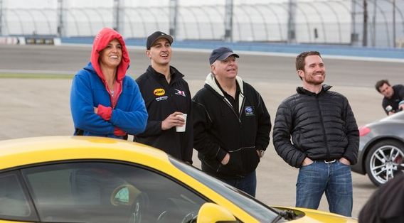 Darra Torres, Graham Rahal, Larry Sharp, and Brian Vickers watch the action