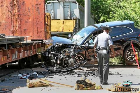 Porsche1.porsche cayenne hit by train
