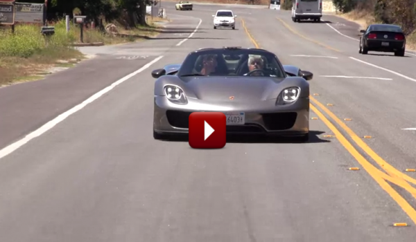 Jay Leno driving porshce 918 spyder with play button