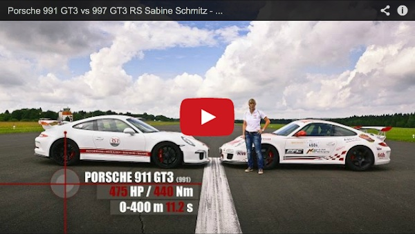 sabine schmitz standing between a porsche 997 gt3 rs and a porsche 991 gt3 on the track