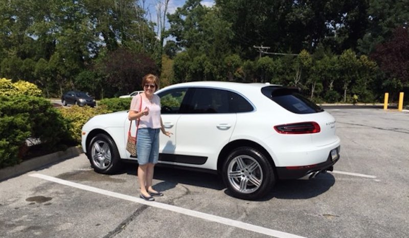 Christine taking delivery of her new Macan