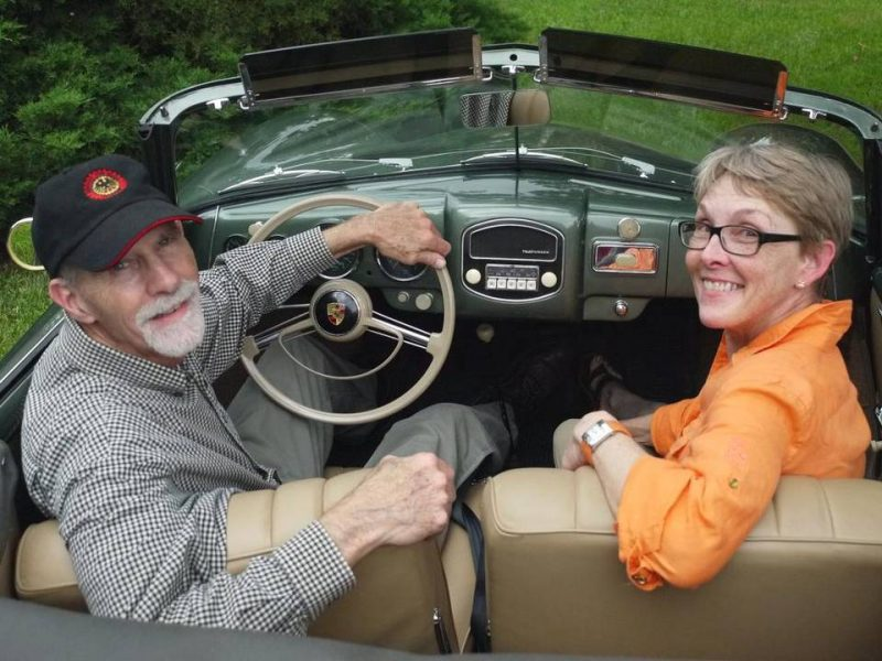 Life is good in their Porsche for Bill and Kathleen Pierson of Salina. Mike Berry The Wichita Eagle