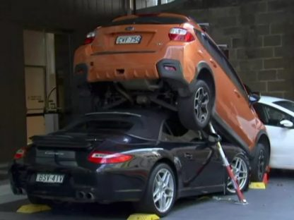Australian Valet Driver Accidentally Parks Porsche 911 Underneath Subaru