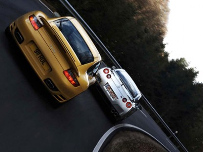 Godzilla Takes on the 480-hp Yardstick. Porsche 997 Turbo vs. Nissan GT-R