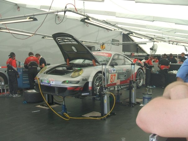 Wolf Henzler's Porsche GT3 being repaired during 12 Hours of Sebring