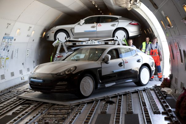 Porsche Panamera loaded into the cargo hold of a Boeing 747