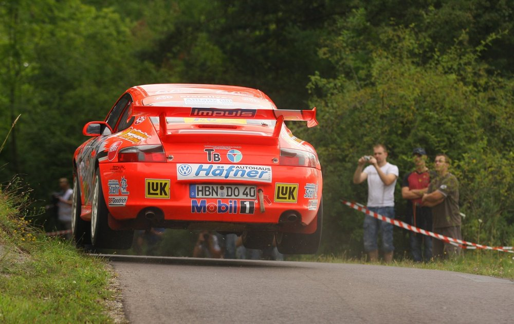 getting air at the Eifel Rally in a Porsche 911 GT3