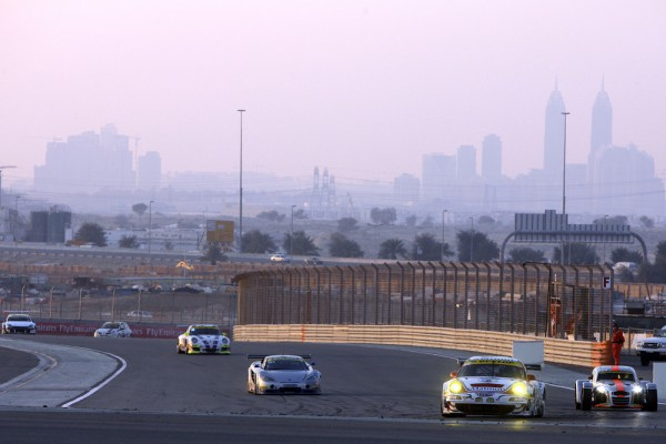 porsches racing at the dubai autodrome