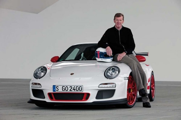 Porsche's Walter Rohl sitting on the hood of a 2010 911 GT3 RS