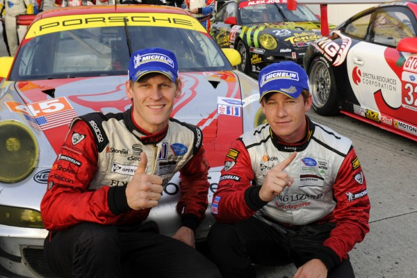 Porsche's Joerg Bergmeister and Patrick Long posing in Long Beach