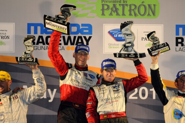 Porsche's Patrick Long and Joerg Bergmeister of the Flying Lizard Team accepting a trophy in Monterey at six hour ALMS event