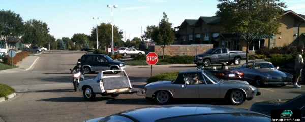 A Porsche 914 towing half of another porsche 914