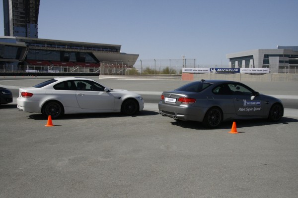 bmws lined up at dubai autodrome for michelin pilot super sport event