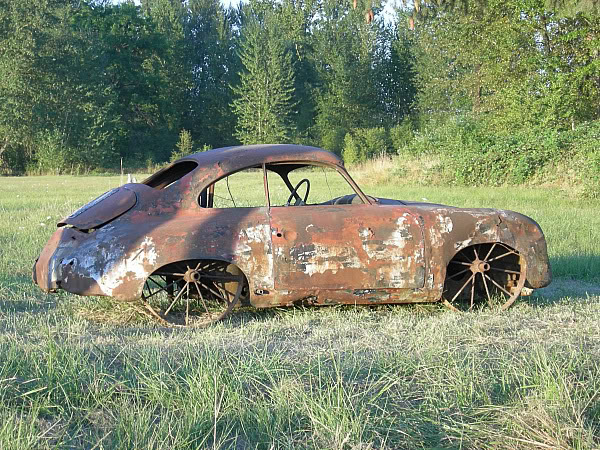 A Porsche 356 Rusting in the Field