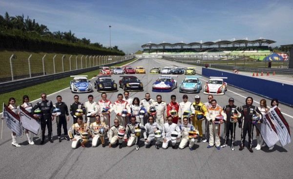 dlrivers posing in from of carrera cup asia porsches