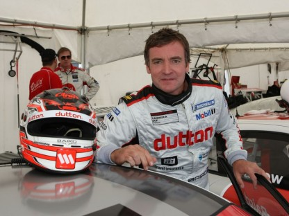 Craig Baird Leaning on Porsche Carrera Cup Car