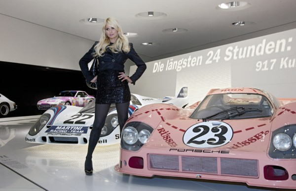 Paris Hilton posing with a Porsche 917 know as the Pink Pig