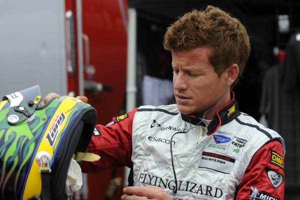 Patrick Long inspecting his helmet at Lime Rock ALMS