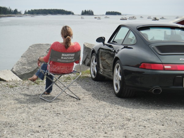 Sitting in a Porsche Design Driver's Selection Martini Racing Beach Chair