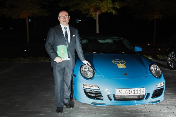 Bernhard Meier, posing with Porsche 911 Speedster Golden Classic Steering Wheel
