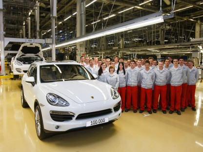 porsche factory works pose with 100000th Porsche cayenne