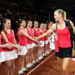 Maria Sharapova shaking hands with the ball girls at the 2012 Porsche Tennis Grand Prix
