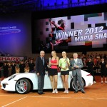 Maria Sharapova accepting the trophy for the 2012 Porsche Tennis Grand Prix