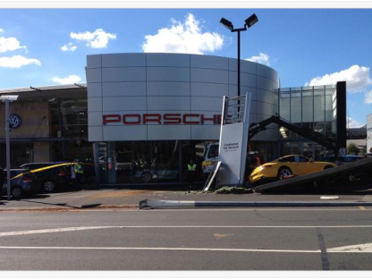 Out of Control Truck Crashes Into a Porsche Dealership