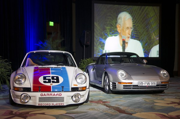 Brumos Racing Porsche and a 959 to the right of the stage