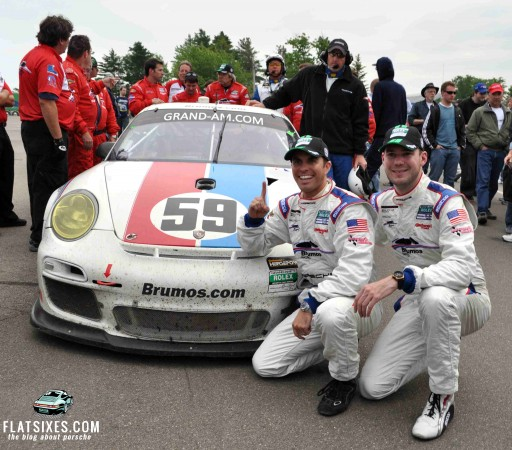 Andrew Davis and Leh Keen in front of Brumos Racing Porsche #59