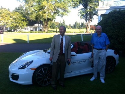 Peter Jones and his father Sheldon in front of the Porsche he won for hitting a hole-in-one