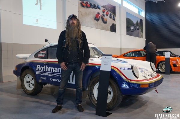 Magnus Walker at Porsche Centre Oakvill standing in front of Rally prepped 911