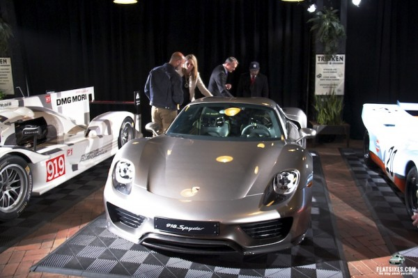 Daymond John taking a close look at the Porsche 918 Spyder