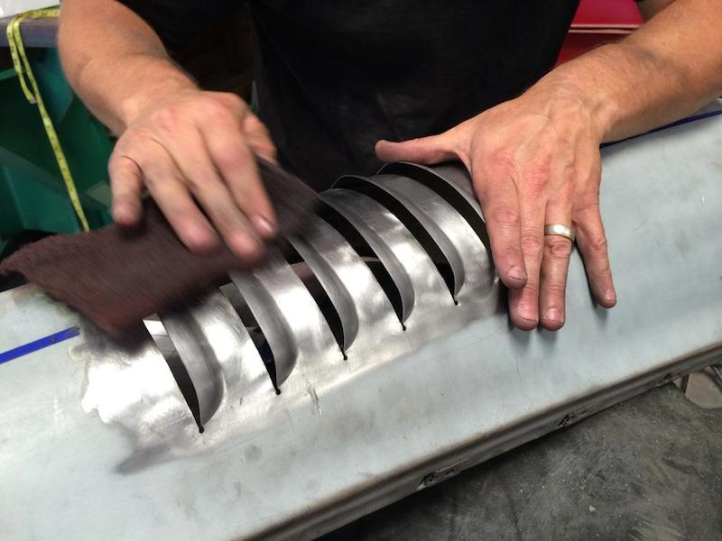 Rod applying some finishing touches on louvers for a special 911 for Mr. Urban Outlaw, Magnus Walker