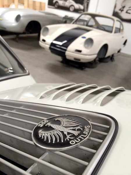 Foreground:  The cherished badge denoting an Emory Outlaw which Gary and Rod also gift to owners of special cars built in the Outlaw tradition.  But don't let that distract you from the 911 Hot Rod taking shape in the back!