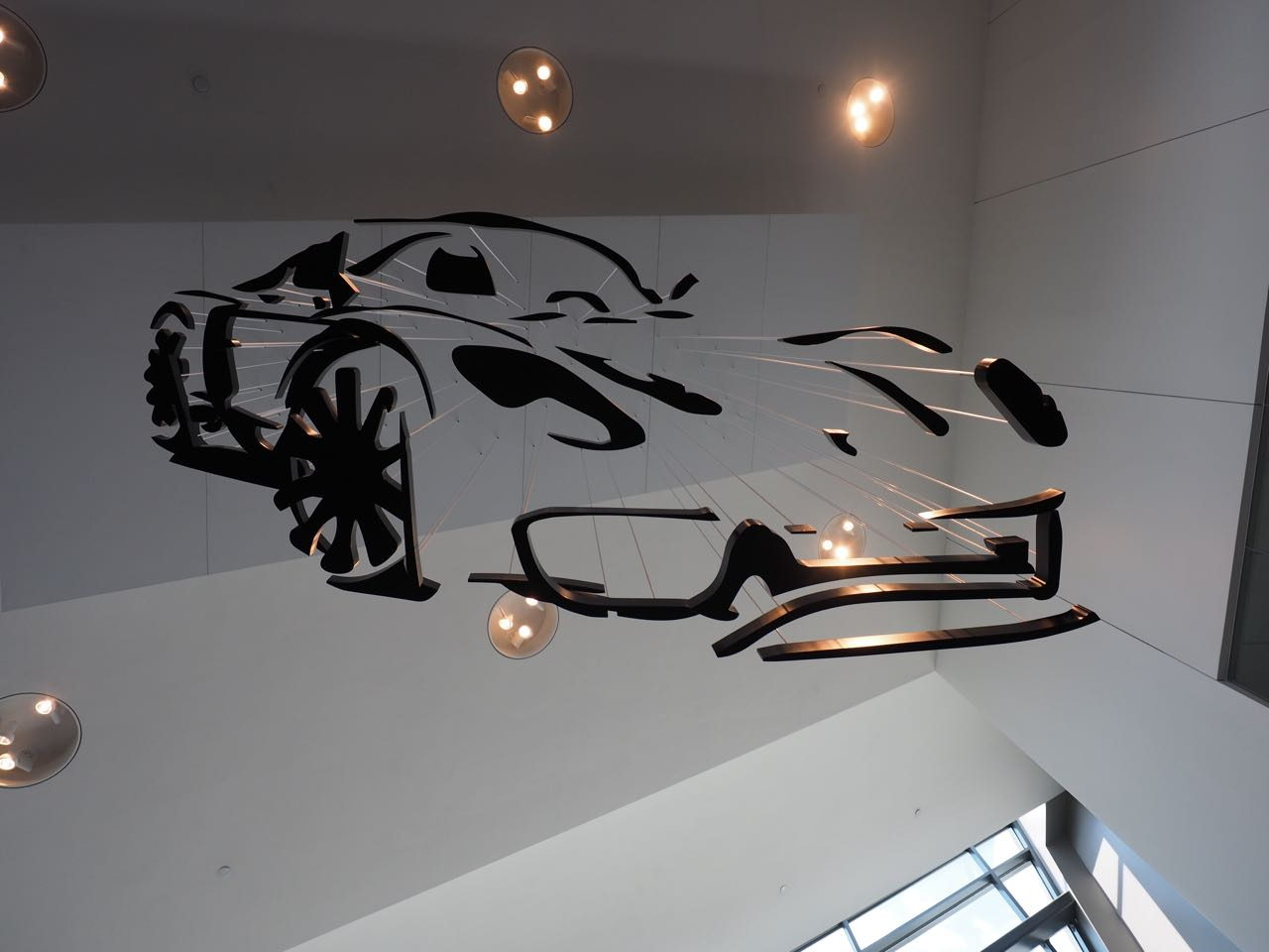 Once you arrive you're immersed in a fantasy world of all that is Porsche from the 917K that greets you at the front desk to the 918 sculpture/optical illusion hanging from the ceiling.