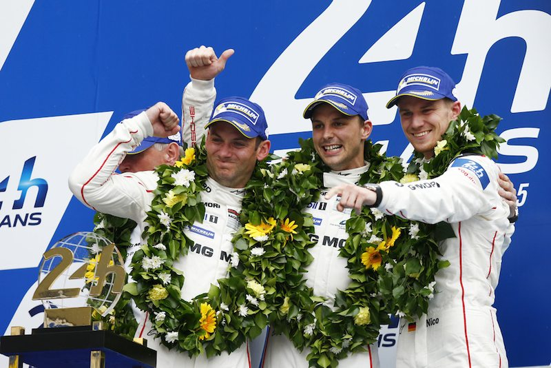 drivers of Porsche#19 on the podium at Le Mans